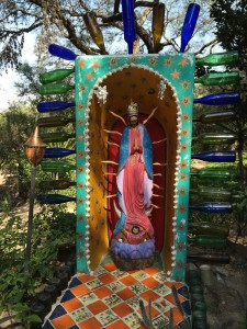 The Virgin of Guadalupe surrounded by bottles!
