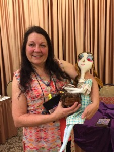 Marie Kennedy with one of Lulu's dolls.